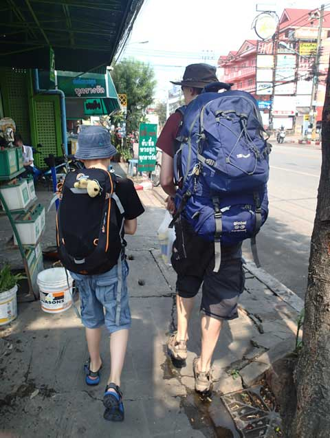 Dad and son backpackers on the street in Chiang Mai