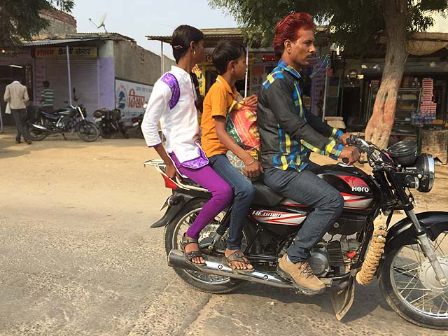 Motorbike passengers in Rajasthan. Indian driving.