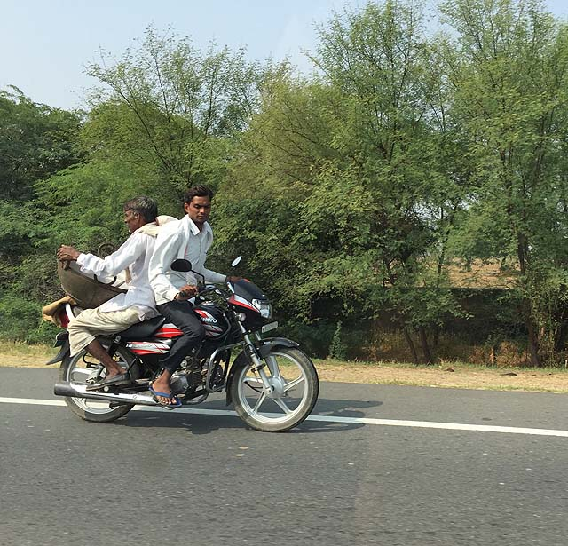 Indian driving. Men on a motorbike, Rajasthan