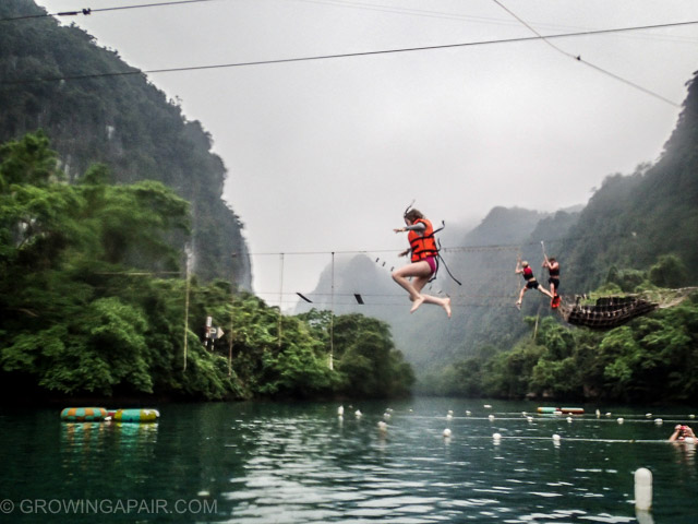 Jumping off the zip line into the river, Vietnam
