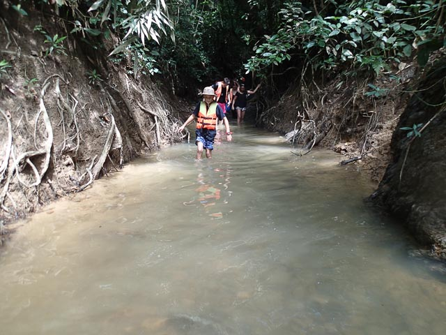 Trekking down a river in Borneo