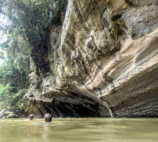 Swimming under the limestone cliff in Borneo