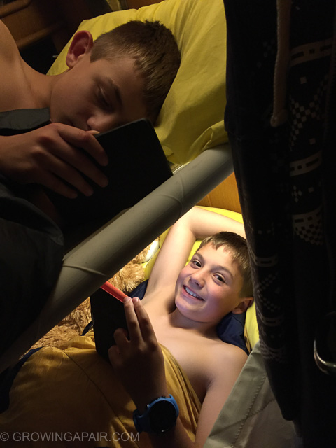 Boys in bunks on the sailing boat