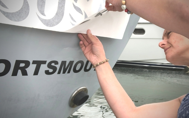 renaming a boat with vinyl transfer stickers