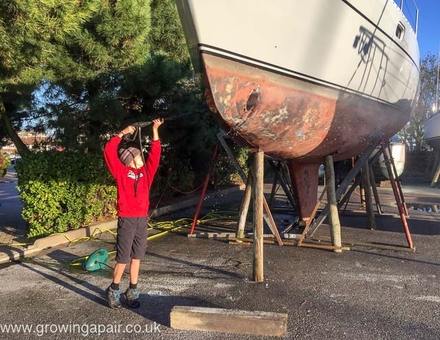washing the hull of a sailing boat in the boatyard