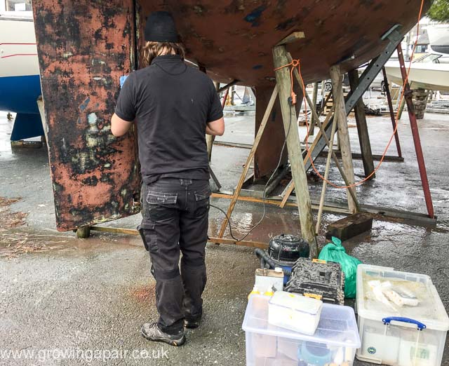 repairing the rudder of a sailing boat