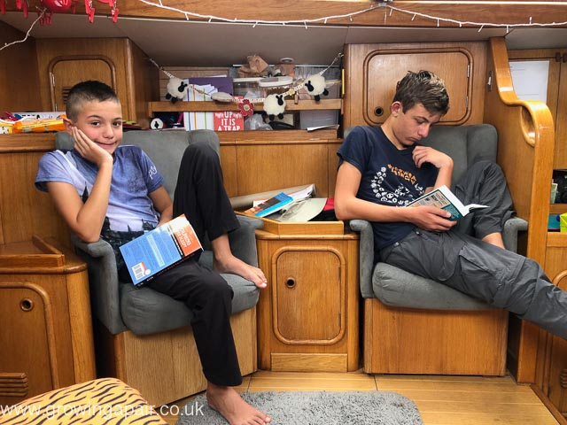 Kids reading in the saloon