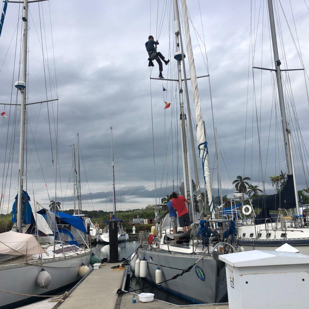Evan up the mast at SBM